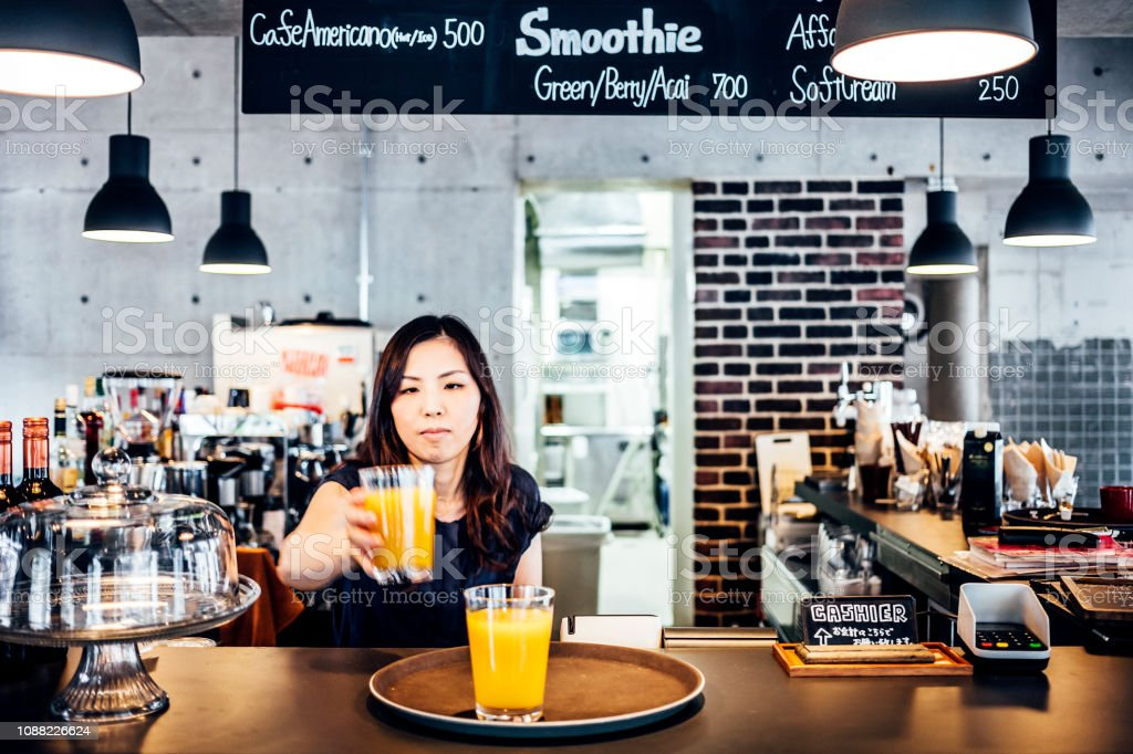Asian woman working in cafe stock photo