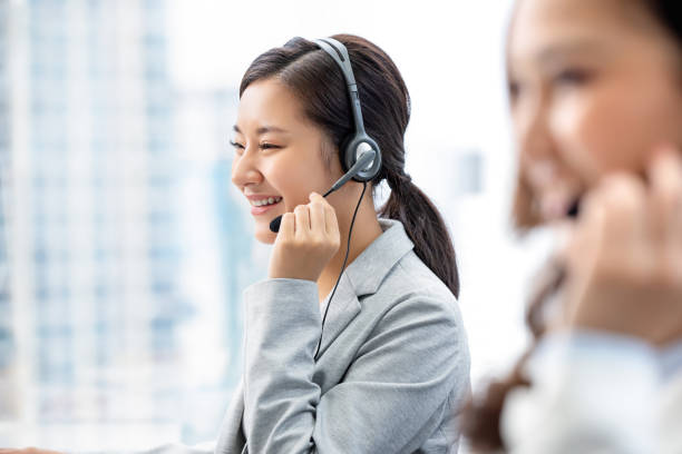 Asian woman working in call center office stock photo