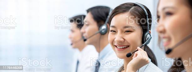 Asian woman working in call center with team picture id1176446058?b=1&k=6&m=1176446058&s=612x612&h=mbzdvfngf68urp exissjqe04l6urmiwhcfoffjptbq=