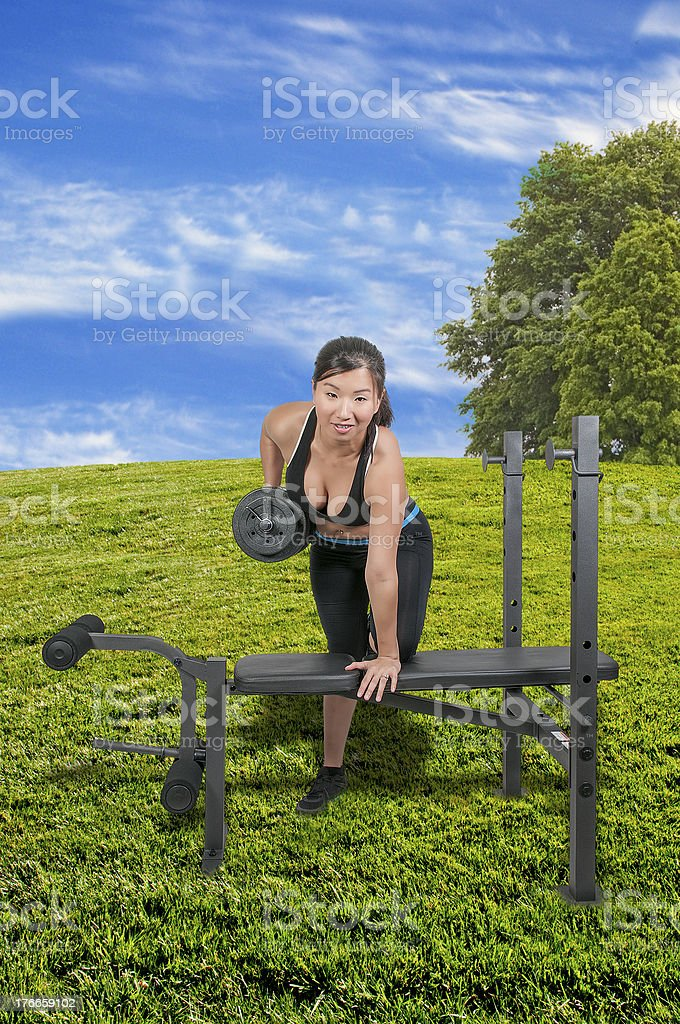Asian Woman Working with Weights royalty-free stock photo