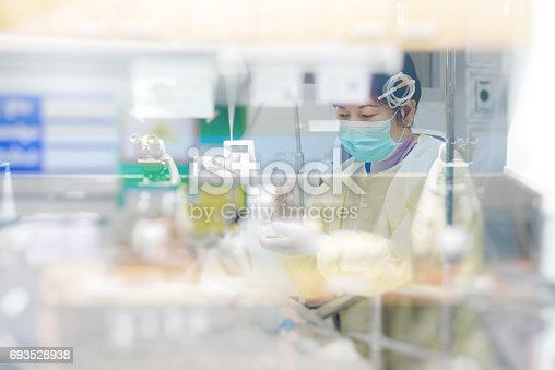 istock Asian women 40s years old in gown coat is a patient relative taking care of the CRE. or VRE. infected elder patient 80s years old on bed in the hospital. 693528938
