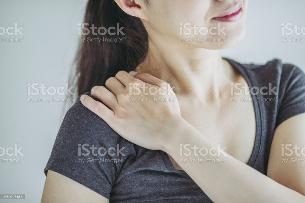 Asian women and stiff shoulders stock photo
