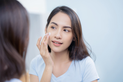 istock Asian women applying face lotion. 1063976592