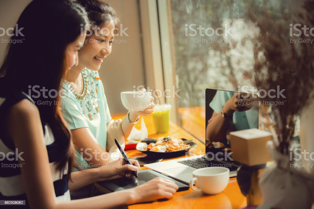 Asian women are freelance work in cafe stock photo