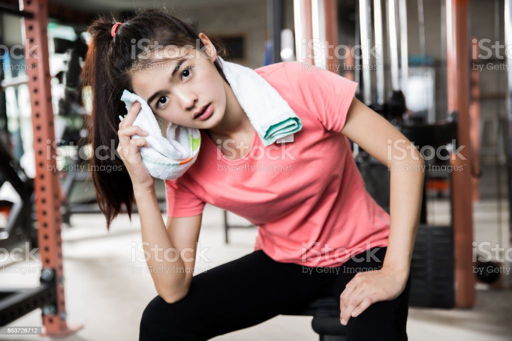 Asian women are resting after a workout gym stock photo