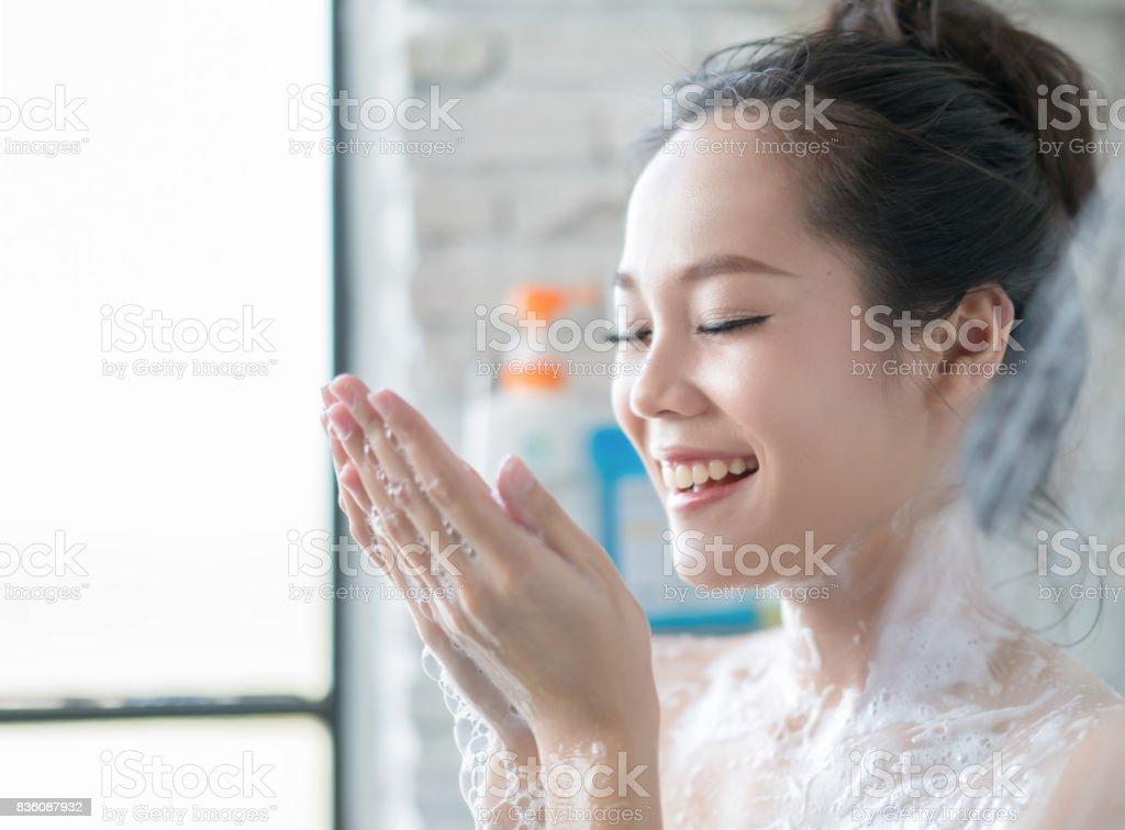 Naked asian women taking shower