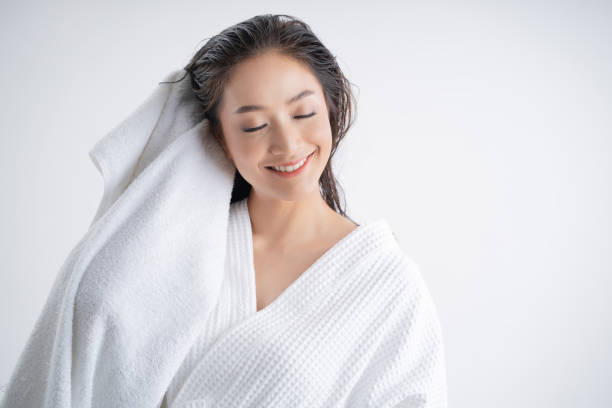 Asian women are using a dry towel to dry their hair.after showering stock photo
