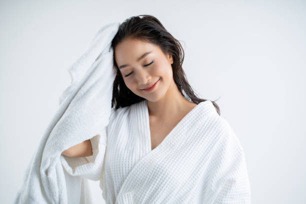 Asian women are using a dry towel to dry their hair.after showering Asian women are using a dry towel to dry their hair.after showering take a bath stock pictures, royalty-free photos & images