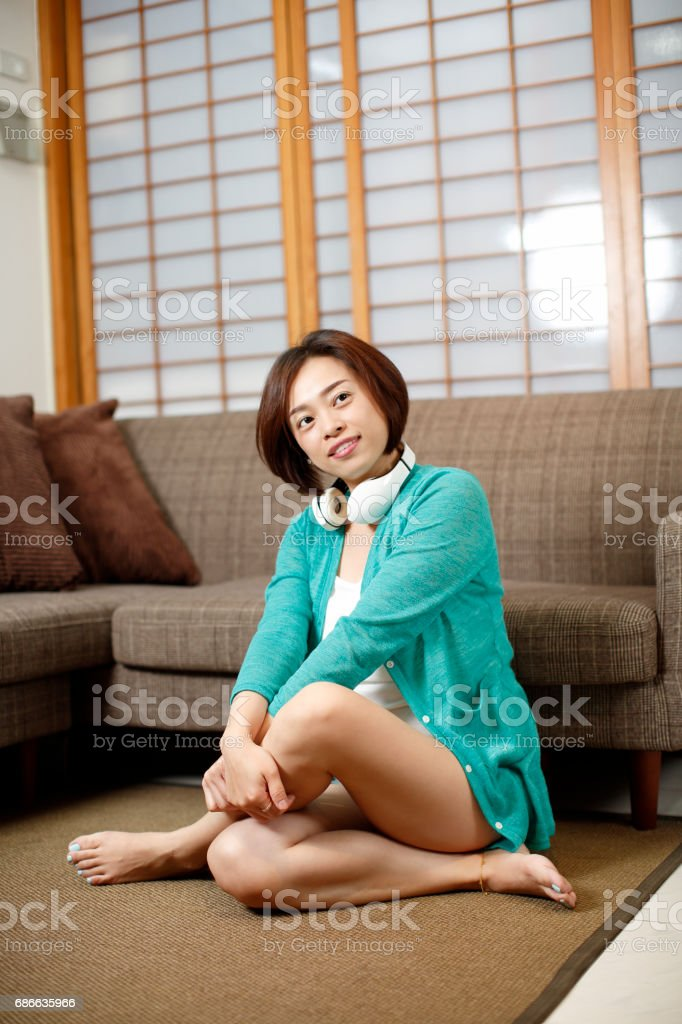 Asian women at home relaxed stretch royalty-free stock photo