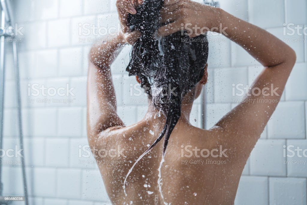 Asian women bathing and she was bathing and washing hair.she is happy royalty-free stock photo