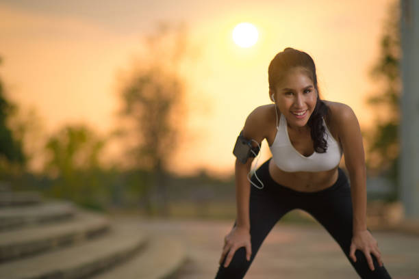 asian women break from jogging - carpet runner stock photos and pictures