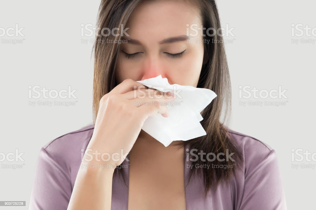 Asian Women In Satin Nightwear Feeling Unwell And Sneeze Against White Background, Dust Allergies, Flu, People Caught Cold And Allergy stock photo