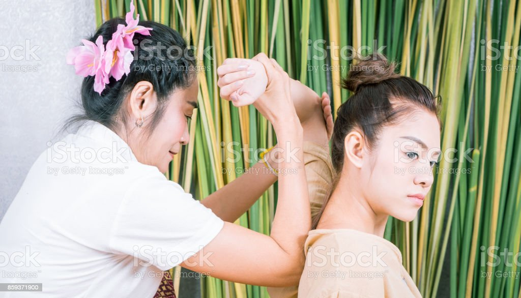 Asian women is getting arm massage position in Thai Spa stock photo