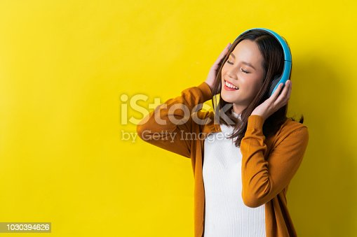 istock Asian women listening to music 1030394626