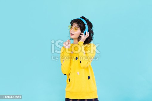 Asian women listening to music