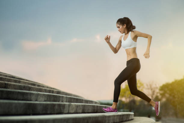 asian women running up the stairs.she is a cardio. - carpet runner stock photos and pictures