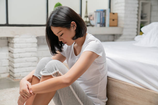 Asian women She is alone And feel lonely Asian women She is alone And feel lonely abortion stock pictures, royalty-free photos & images
