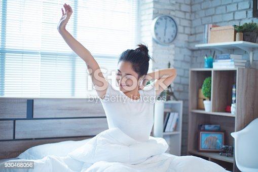 istock Asian women She is in bed and was waking up in the morning. She felt very refreshed. 930468056