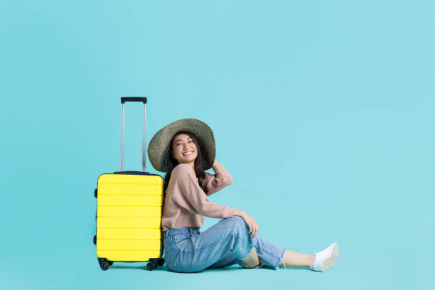 Asian women tourists she is excited to travel.In the studio stock photo