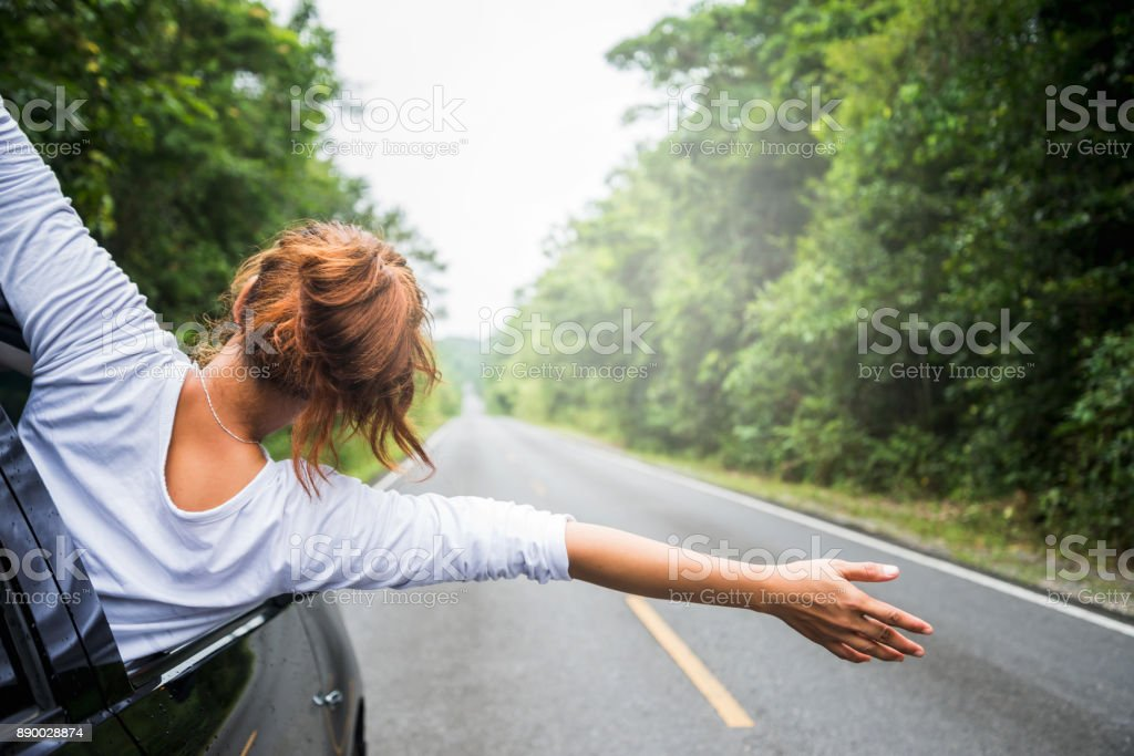 Asian women travel relax in the holiday. driving a car traveling happily. stock photo
