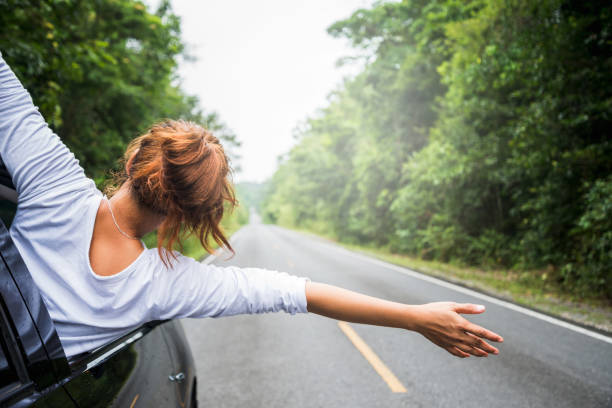 asian women travel relax in the holiday. driving a car traveling happily. - independence stock photos and pictures