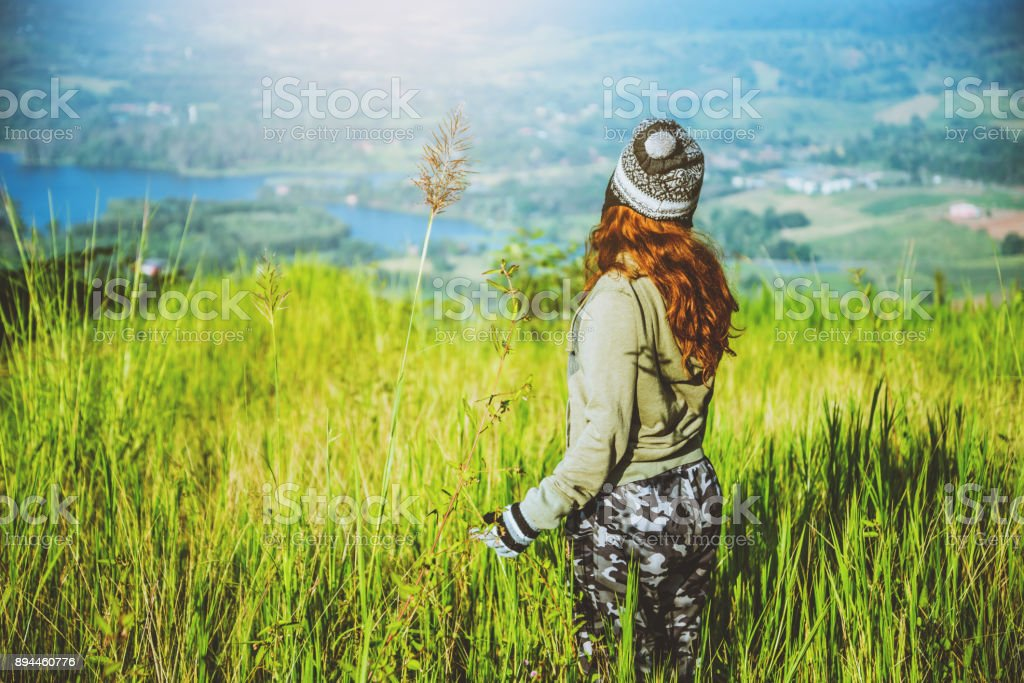Asian women travel relax in the holiday. green pasture on the Mountain. Thailand stock photo
