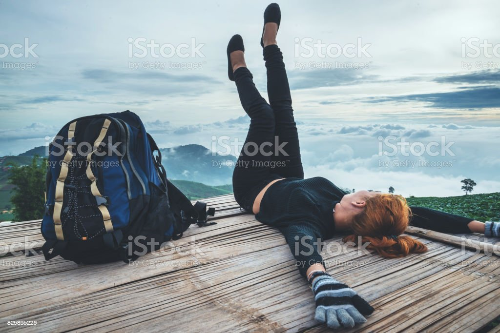 Asian women travel sleep relax. Morning atmosphere nature Forests, mountains. Phu Thap Buek Thailand stock photo
