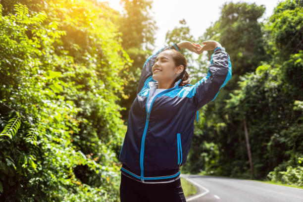 asian women warm up by stretching in the morning. - resilience concept stock photos and pictures