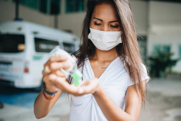 Asian women wear masks use antiseptic gel Asian women wear masks use antiseptic gel to protect disease antiseptic stock pictures, royalty-free photos & images