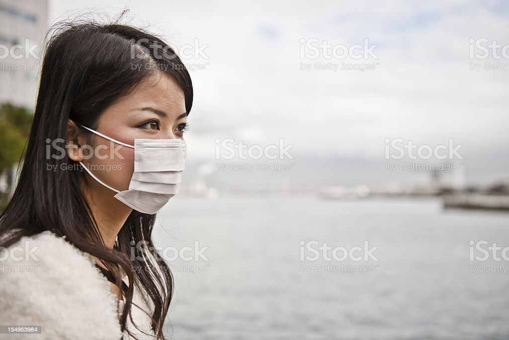 Asian Women wearing facemask stock photo