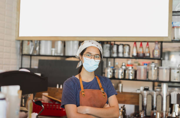asian women wearing protective mask standing in cafe during covid-19 preventing. - covid restaurant imagens e fotografias de stock