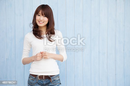 istock Asian women with blue background 483786241