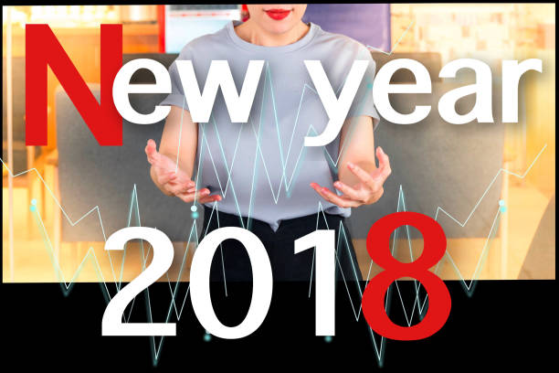 Asian women with number 2018 vector for happy new year image.To the hospital and everyone on a office background.  Using life insurance or Health, business welcome new year photo. stock photo