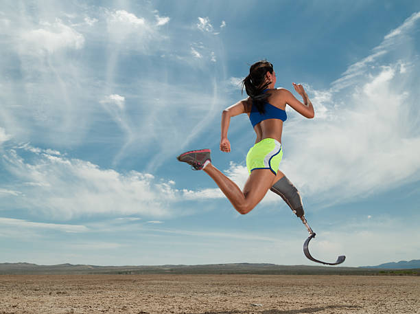 asian women with prosthetic leg running in the desert - protesutrustning bildbanksfoton och bilder