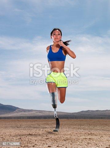 istock Asian Women With Prosthetic Leg Running In The Desert 627763686