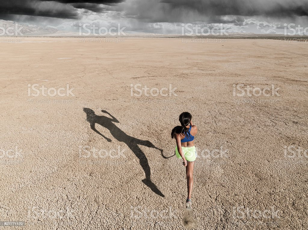 Asian Women With Prosthetic Leg Running In The Desert stock photo