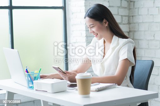 istock Asian women working now The desk at her home she is happy. 907903898
