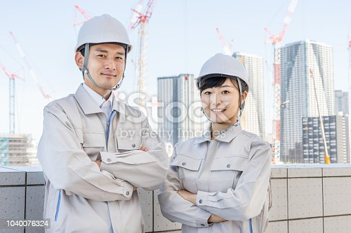 asian worker working in construction site