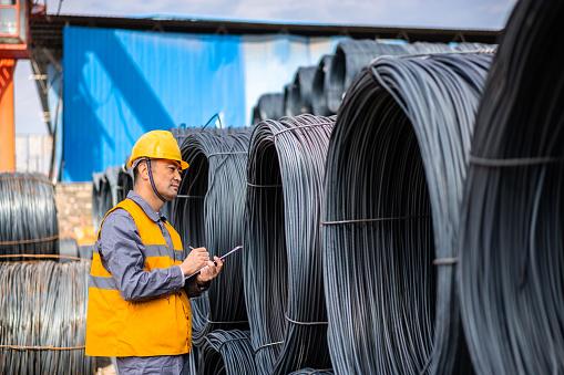 Asian worker working in the steel market