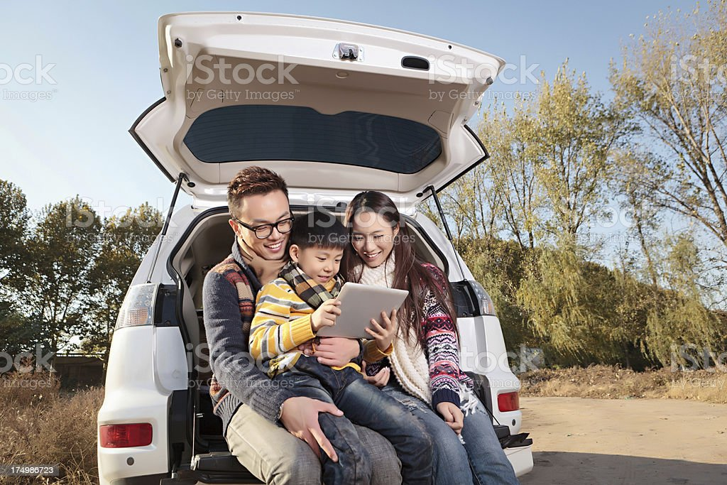 Asian young family driving to travel in the autumn holiday stock photo