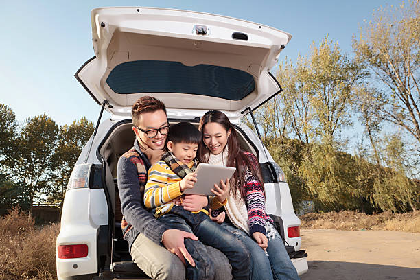 asian young family driving to travel in the autumn holiday - asian travel in car stock photos and pictures