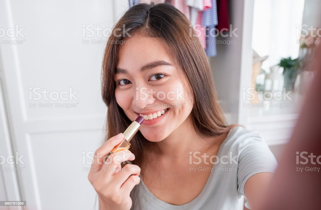 Asian Young Female Blogger Recording Selfie Vlog Video With Makeup