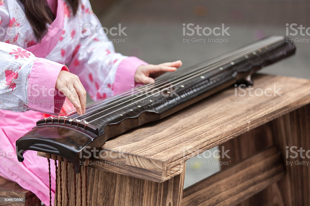 Asian young girl play on zither stock photo