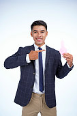 Asian young handsome business man isolated on white background with copy space