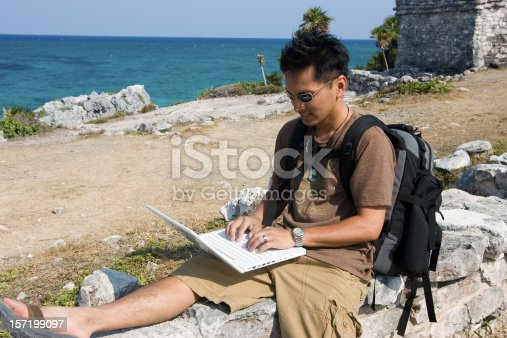 istock Asian Young Man Hiking in Mexico Using Laptop, Copy Space 157199097