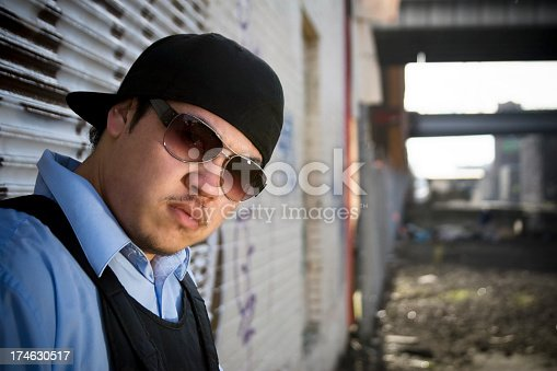 521022435istockphoto Asian Young Man Hip Hop Dancer Portrait in Urban Downtown 174630517