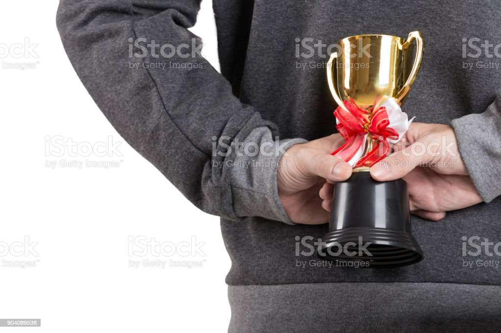 Asian young man hold a trophy stock photo