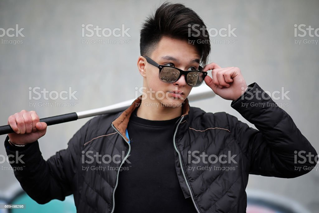 Asian young man on the street posing at the camera stock photo