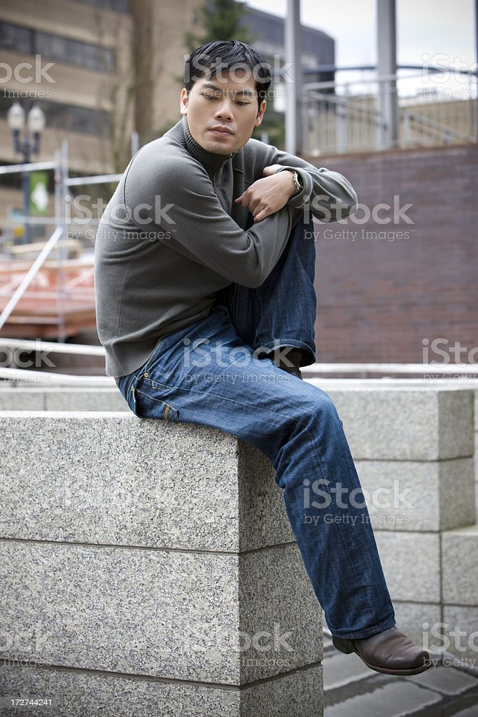 Asian Young Man Portrait Downtown, Looking Down and Thinking, Copyspace stock photo