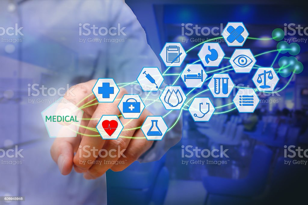 Asian young man pressing medical icon on virtual screen. Healthcare stock photo